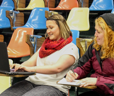 two young Salem University students collaborating in lecture hall